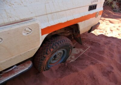 4 WD driving in the Gibson Desert, trying to get a broken-down vehicle back on the road by WA Tours driven by Otto Tours