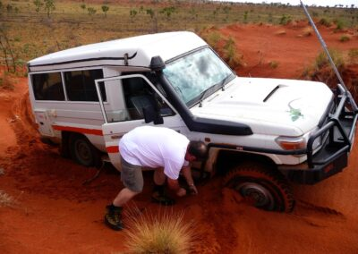 Canning Stoch Route - 4 WD driving in the Great Sandy Desert dug into the soft, deep red sand by WA Tours driven by Otto Tours